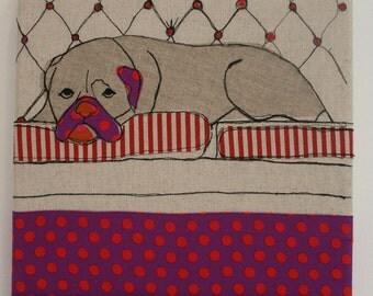 Bull dog resting on the sofa