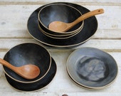 lovely black bowls with plates for soup or salad or cereal...