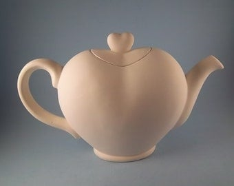 Heart Tea Pot ( gare - 3289) bisque you paint. Clear Glazed inside only.