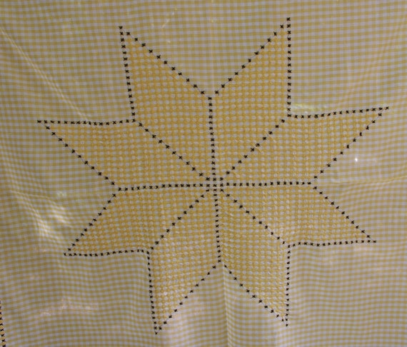 Gingham fabric tablecloth with chicken scratch embroidery