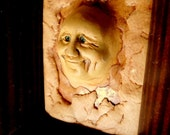 What a great smile you have.- Framed Clay Face