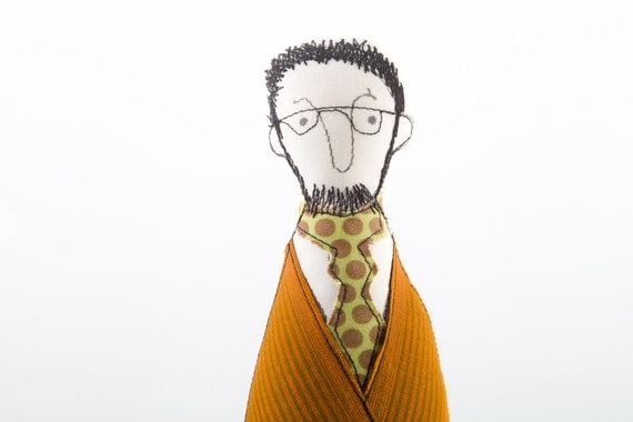 Bearded man in glasses wearing an orange jacket, green tie dotted and striped brown pants, ooak handmad cloth doll for him