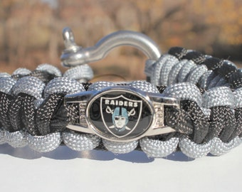 Officially Licensed Oakland Raiders Charm on Custom Made 550 Paracord Survival Strap Bracelet Anklet with Stainless Steel Shackle