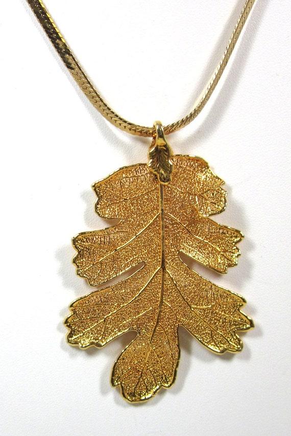 gold filigree maple leaf pendant serpentine chain gold