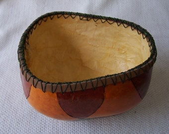 Medium apple gourd bowl, wood burned pattern dyed assorted fall colors, mulberry paper inside. 1433.
