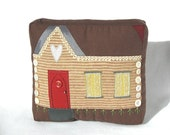 Cozy cabin patchwork pillow with button trim