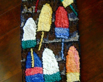 Hooked rug-Lobster Buoys on shed