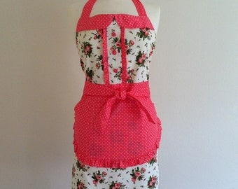 Retro apron with collar, coral peach floral on a cream fabric, fully lined.