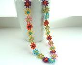 Lace flower necklace, daisy in bright colours, pretty, delicate, light, feminine, orange, yellow, pink, blue, purple, green