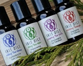 Iris Oils: Aromatherapy & Massage Oils for Childbirth  ~ Four,  1 oz. bottles, packaged in vinyl carrying case
