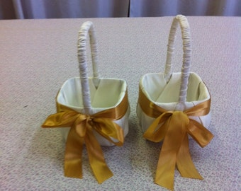 Set of two Ivory Flower Girl baskets with Gold Accent Bow