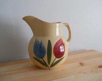 "Watt pottery Rare 6.5"" pitcher with Tulip pattern"