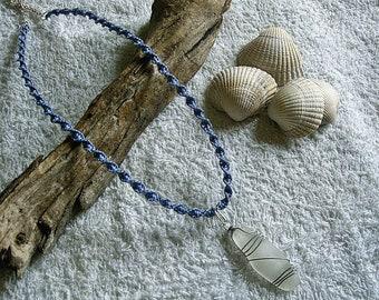 Sea glass pendant on a macrame necklace. Sea glass jewelry. Macrame jewelry.