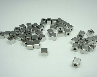 F-61. Original Rhodium Plated  Mini Cube Beads