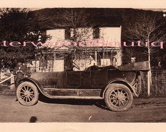 Early 1900's stretch photo of automobile in front of the house.