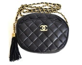 CHANEL 2.55 black leather quilted shoulder chain purse bag  with gold CC logo and tassel