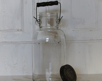 Vintage  Half Gallon Glass Bottle with Wood Handle and Original Lid .. Farmhouse / Country Charm