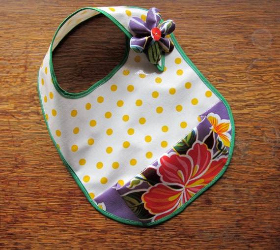Baby Girl's Wipeable Bib in polka-dots and flowers