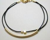 Minimalist gold tube stacking bracelet in black