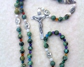 Rosary: green and black Ave beads and foral silver Pater beads