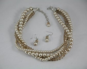 Statement necklace in Twisted champagne pearl necklace with champagne crystals
