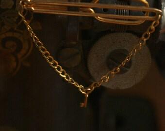Tie clip with golden key