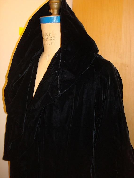 Swing coat with dramatic hood
