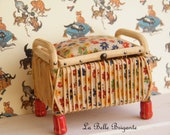 Vintage dollhouse rattan stool with opening lid.