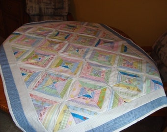 Baby crib quilt in multi colors
