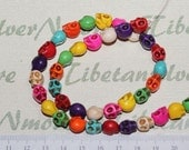 16 inches per pack of 10x8mm 3D Skulls top to the bottom drilled Multi-color Dyed Magnesite.