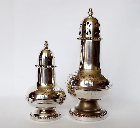 RESERVED - Two silver plated sugar shakers or muffineers from England - hand engraved