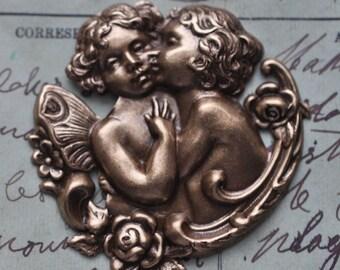 Kissing cherubs centerpiece, oxidized brass