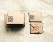 Rustic Craft mini envelopes set of 15, hand stamped with Alice in Wonderland pictures, vintage look, ink postal stamps