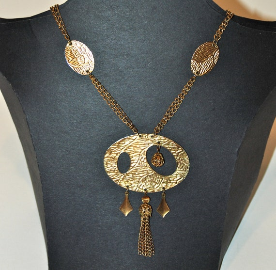 Women's necklace, asymmetrical gold pendant with tassel, 1960s - 1970's.