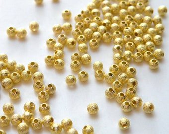 50 Gold Stardust spacer beads round plated copper 4mm DB01254