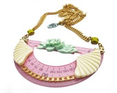 Geometric ruler necklace, pink plastic with mint flowers and cream fans, gold plated chain and deer