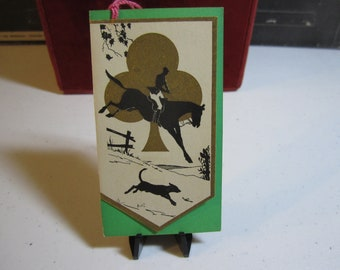 Art Deco 1920's die cut gold gilded silhouette of an equestrian riding a horse and a dog running  in the countryside