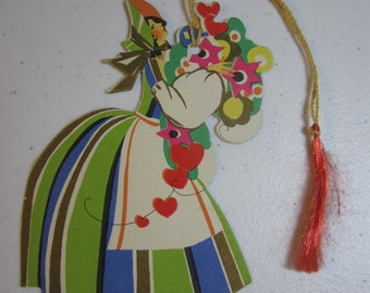 Art Deco 1920's-30's  die cut Buzza  bridge tally card lady wearing colorful hat and  dress with bouquet of stylized flowers and red hearts