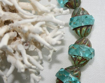 11x10mm . Czech glass aqua blue with picasso carved turbine . 5 beads