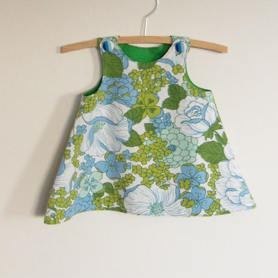 Pinafore dress with multi-color hand-embroidery, c rewel work style. The flowers and vines twirl all around the skirt. The flowers and vines twirl all around the skirt. Ideal to combine with shorts, tights, jeans or by itself in the summer.