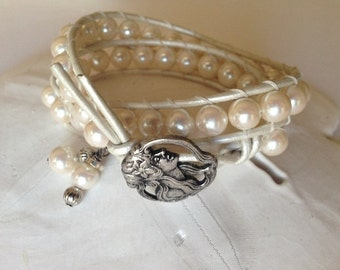 Faux pearl double wrap ladder bracelet with pearl white leather cord, dangle charms and vintage button closure.