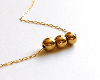 CLASSIC >> 14k gold dots threaded on super delicate 14k chain << basically its awesome