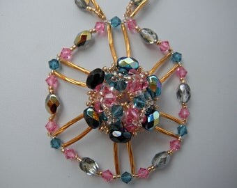 Swarovski Flowers in the Round in Teal, Pink, and Black Ab Crystals mixed with gold and clear seed beads