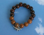 For kids yogi inspired wood bead worry bracelet with dinosaur charm and wood beads