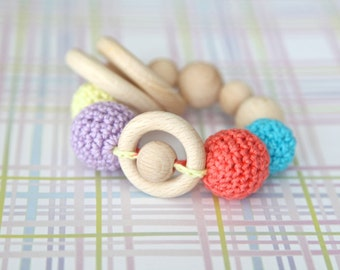 Teething rings toy rattle with crochet wooden beads and 3 wooden rings. Yellow, lavender, aqua blue, coral.