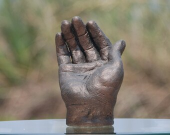 Receiving Right Hand Sculpture, white clay with gold finish