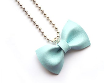 BLUE BOW NECKLACE in pastel tone