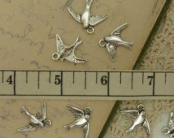 10 antiuqe silver tone swallow / flying bird charms  size 22 mm by 18 mm