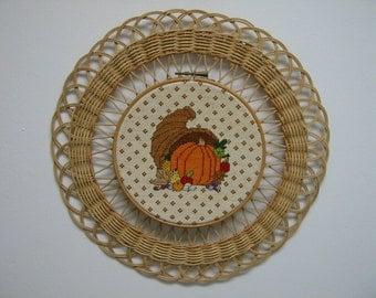 vintage Fall/Thanksgiving cross stitch scene mounted on wicker