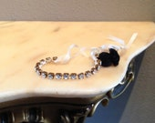 Genuine Swarovski Friendship Bracelet, Crystal Wrapped Bronze Metal Chain with Pearl Closure and Black Yarn Tassel